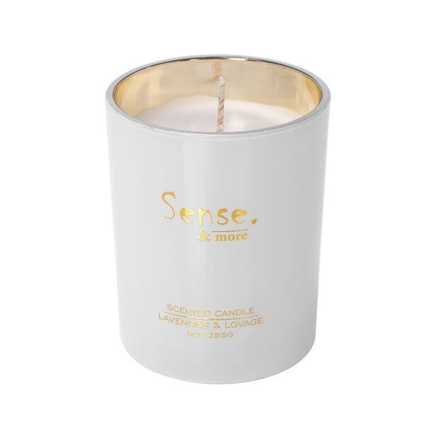 شمعة معطرة في وعاء زجاجي ملوّن برائحة اللافندر والكاشم image number 0